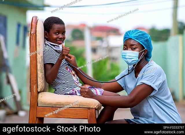 Doctor listening to child's chest