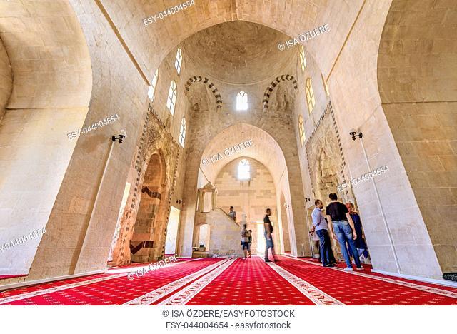Unidentified people visit and explore Zinciriye Madrassa, a popular landmark in Mardin, Turkey. 17 June 2018