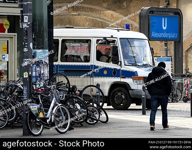 27 January 2021, Berlin: A police car is parked on Alexanderplatz. According to the Berlin police, crime in Görlitzer Park and Alexanderplatz has decreased...