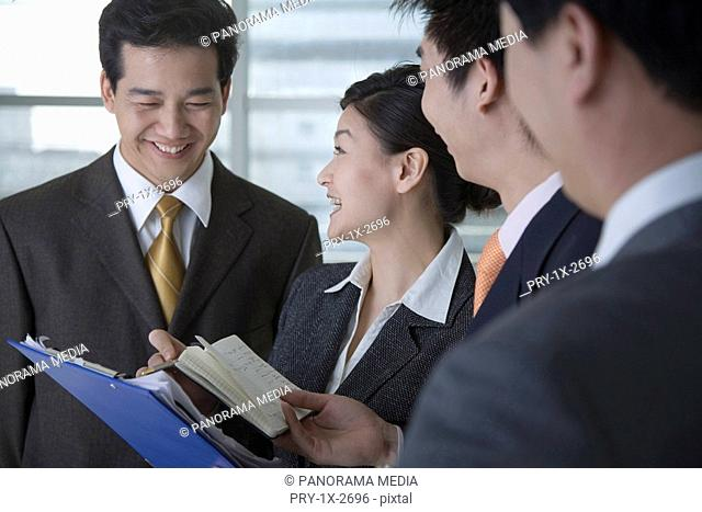 Businessman and woman with file