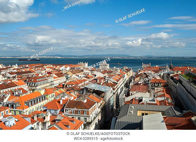 Lisbon, Portugal, Europe - An elevated view of the historic city district Baixa with the Tagus River in the backdrop