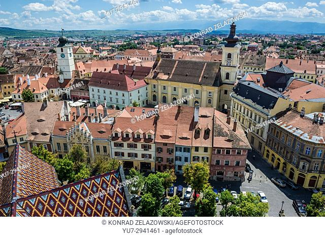 Aerial view with Holy Trinity Church and Council Tower from Lutheran Cathedral of Saint Mary in Historic Center of Sibiu, Transylvania, Romania
