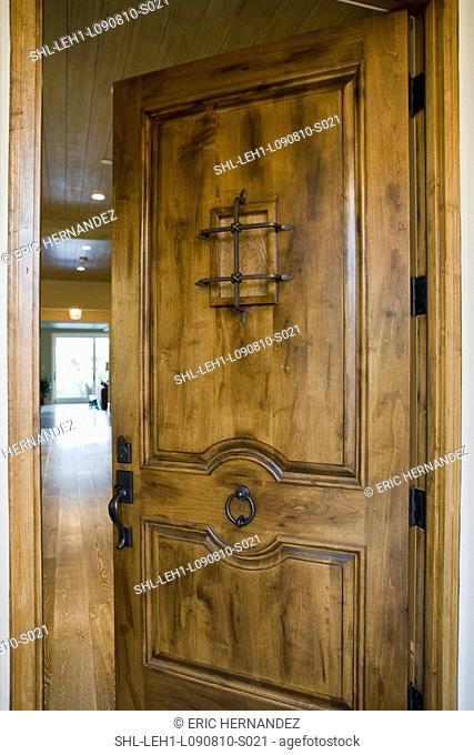 Detail open front door with speakeasy window