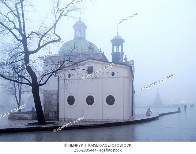 Main Market Square and St Adalbert church at foggy autumn morning, Krakow, Poland