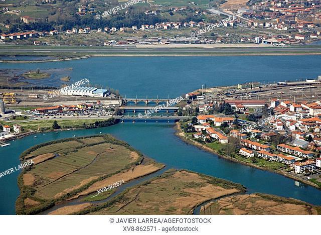 Puente de Santiago (bridge), Irun (left), Hendaye (right), San Sebastian airport and Hondarribia (in background). Bidasoa river mouth, Txingudi Bay
