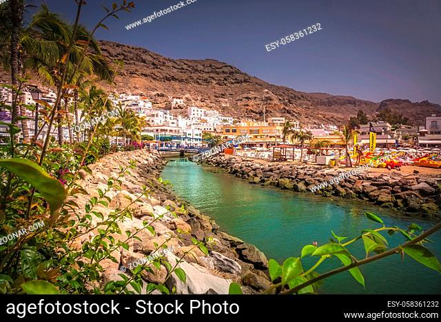 Small river canal in the Puerto de Mogan, a small fishing port in Gran Canaria ( called the Venice of Canaries ), Canary Islands, Spain