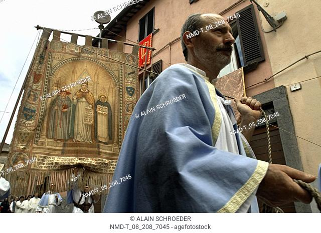 Low angle view of a person carrying a banner, Orvieto, Umbria, Italy