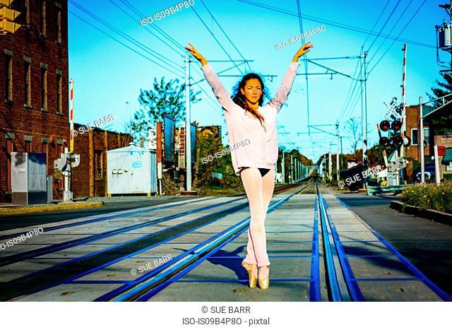 Teenage girl wearing dancewear, dancing, outdoors