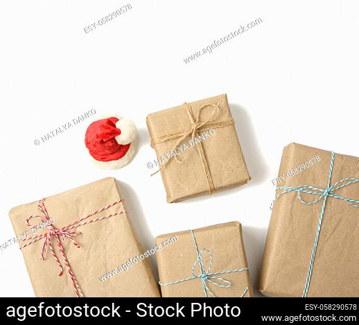 box wrapped in brown kraft paper and tied with rope, gift on white background, top view