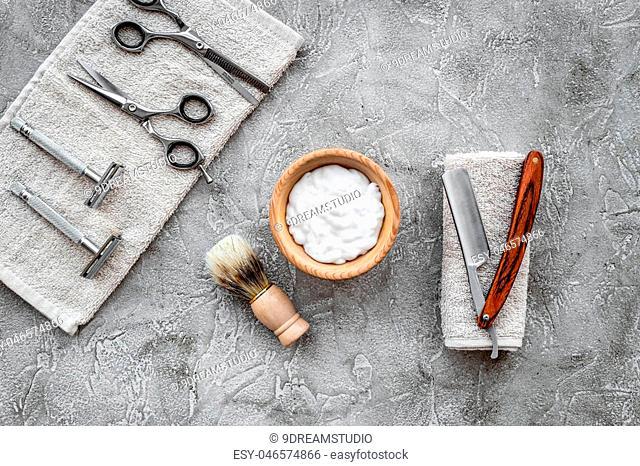 Preparing for men shaving. Shaving brush and razor on grey stone table background top view