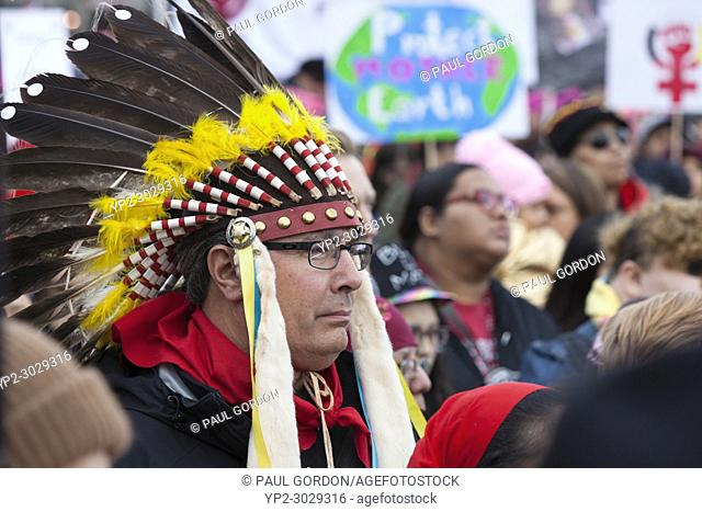 Seattle, Washington: Tribal member wearing a war bonnet as Members of MMIW (Missing and Murdered Indigenous Women) perform an opening prayer and blessing at the...