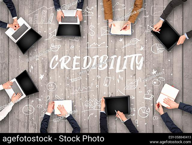 Group of business people working in office with CREDIBILITY inscription, coworking concept