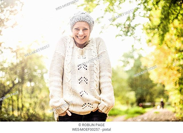 Portrait of happy woman in the forest in autumn