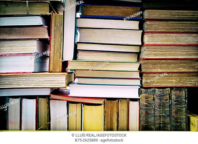 Stacks of books on a shelf