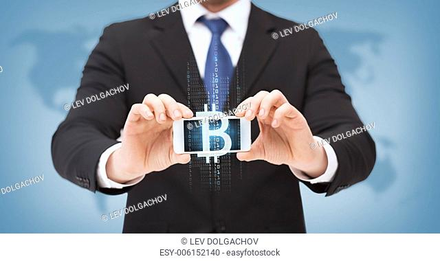 business, internet, money and technology concept - businessman showing smartphone with bitcoin on screen
