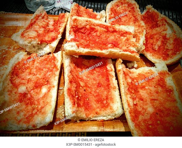 Bread smeared with tomato