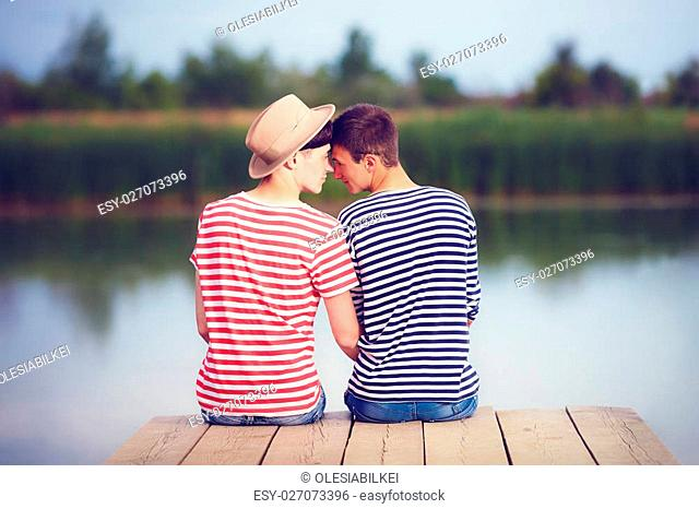 gay couple in love on river bank
