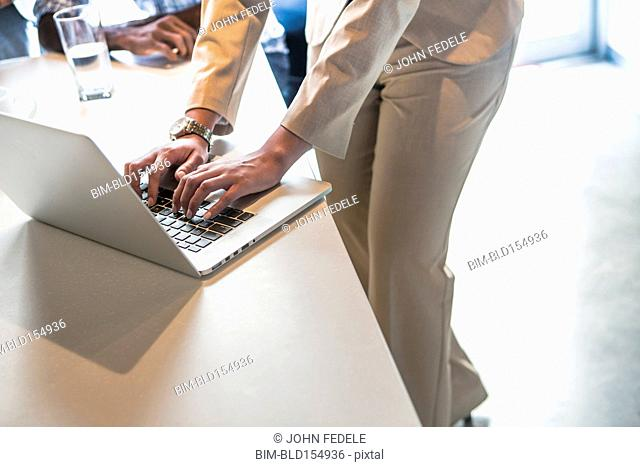 High angle view of businesswoman using laptop in office