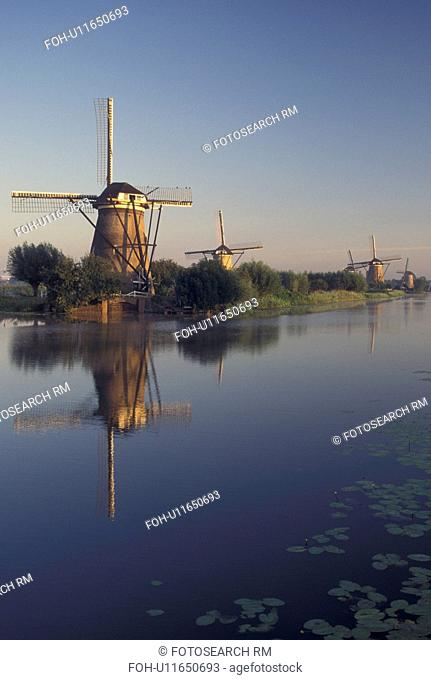 Netherlands, windmill, canal, Kinderdijk, Holland, Zuid-Holland, Europe, Mills of Kinderdijk, Working windmills along a canal in the early morning in Kinderdijk