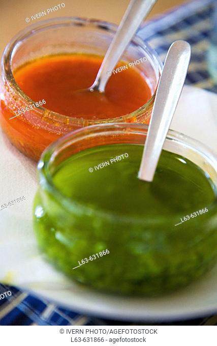 Red 'mojo picón' and green 'mojo verde', typical sauces. Lanzarote, Canary Islands, Spain