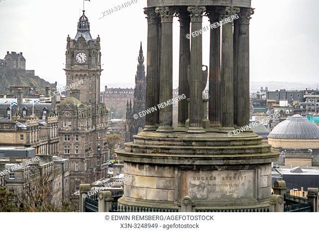 Detail view of Dugald Stewart Monument on Calton Hill set against the capital city of Edinburgh, Scotland