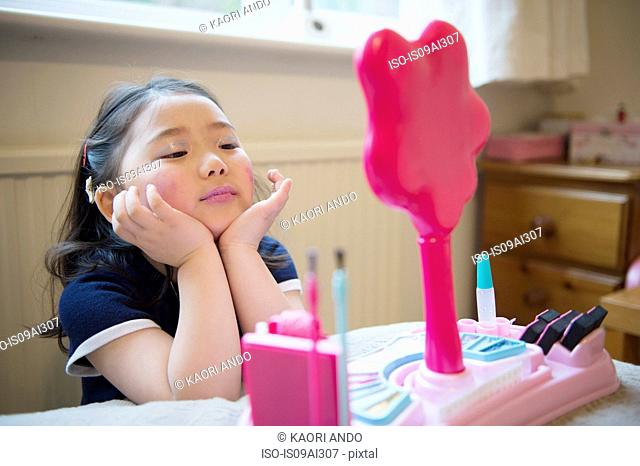 Girl putting make up on