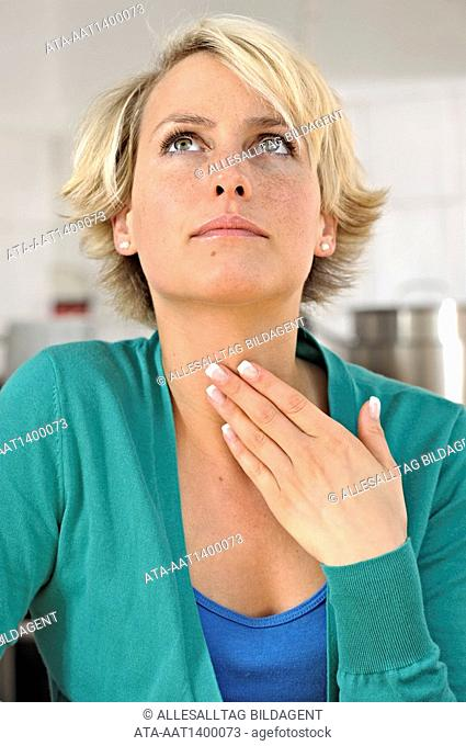 Woman having difficulties in swallowing