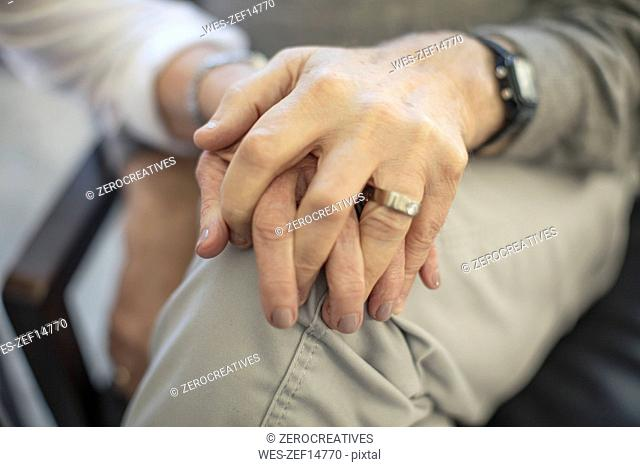 Close-up of senior couple holding hands
