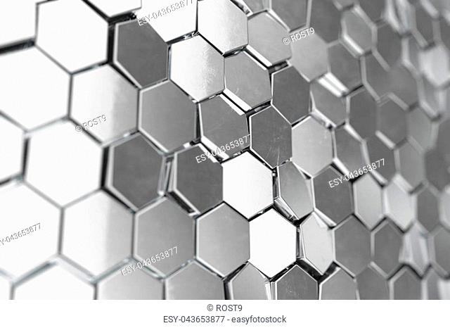 Silver abstract hexagonal background with depth of field effect. Structure of a large number of hexagons. Steel honeycomb wall texture