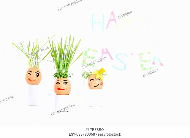 Happy Easter decoration made of egg-shell faces with hair