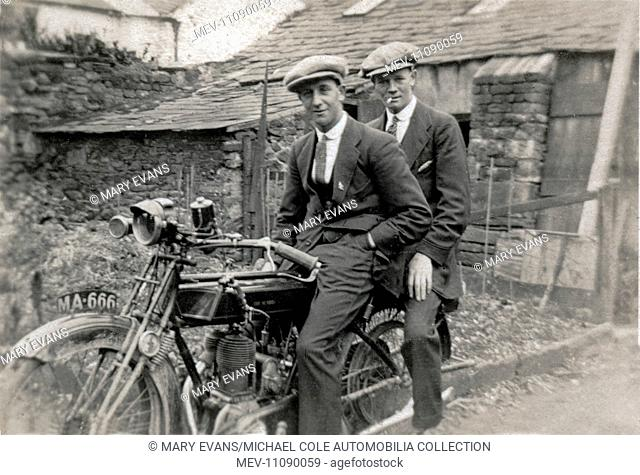 Two young men wearing cloth caps on a 1921 Sunbeam motorcycle in the 1920s