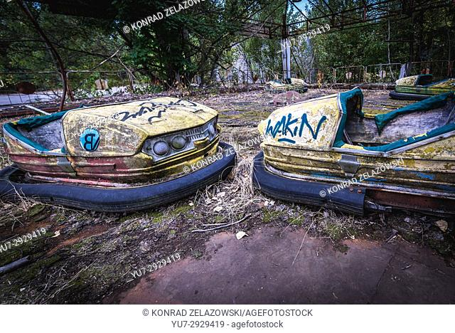 Bumper cars in amusement park of Pripyat ghost city, Chernobyl Nuclear Power Plant Zone of Alienation in Ukraine