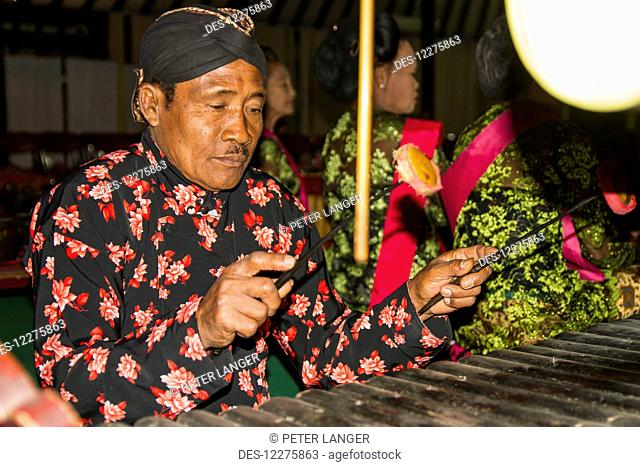 Gamelan orchestra accompanying the Wayang Kulit (shadow puppets) performance by a dalang (puppet master), Yogyakarta, Java Island, Indonesia