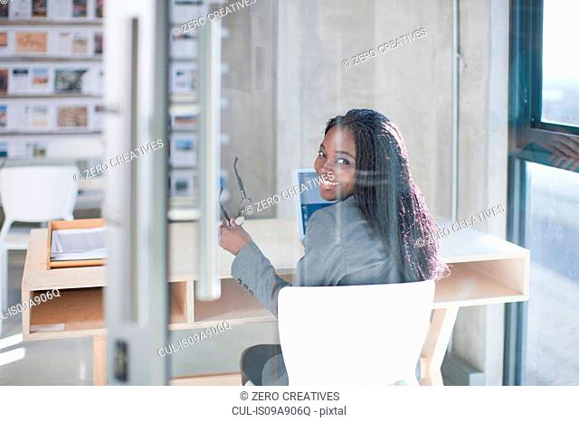 Young woman at desk in office