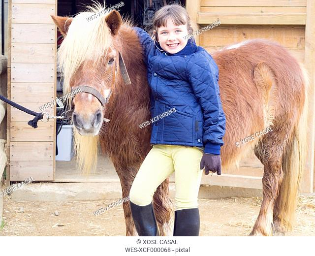 Portrait of smiling girl with pony