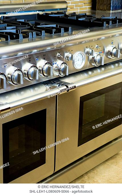 Modern stainless steel oven and knobs