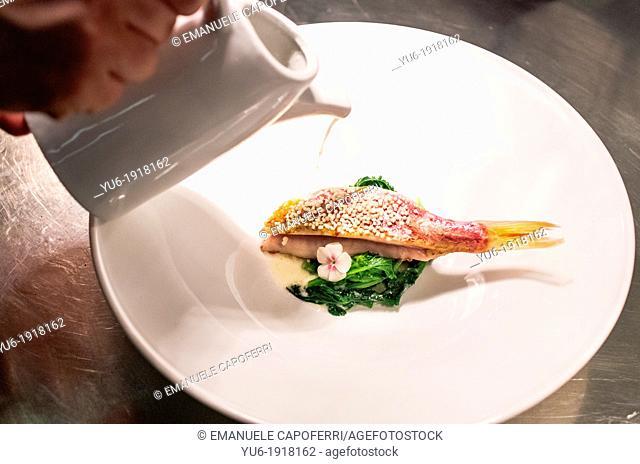 Preparation of a dish of fish of Lake Maggiore, perch