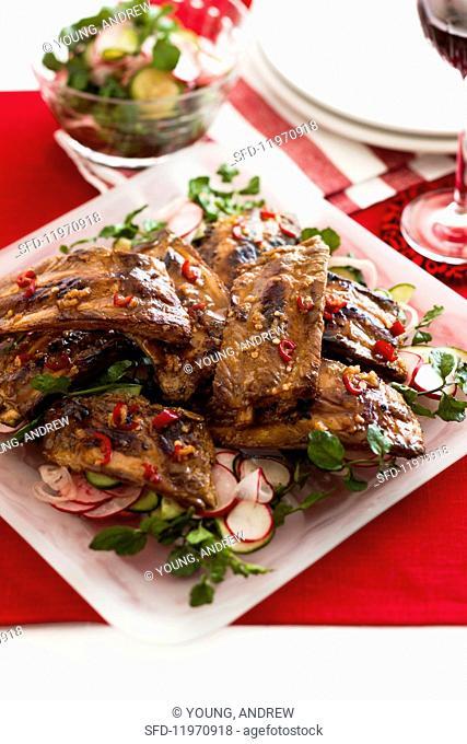 Spicy pork ribs on a radish salad