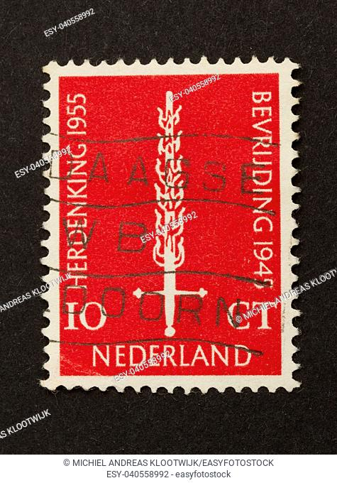 HOLLAND - CIRCA 1950: Stamp printed in the Netherlands shows a burning sword, circa 1950