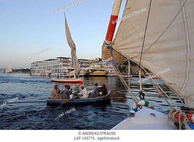 sailing boats fellucas on the Nile, cruise ships in Aswan, Egypt, Africa