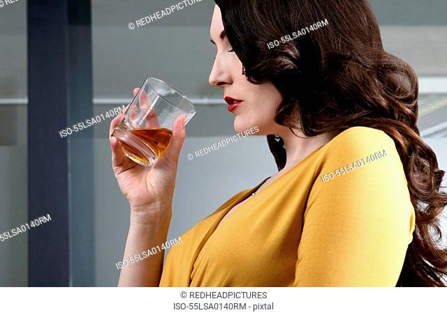 Business executive with drink in hand