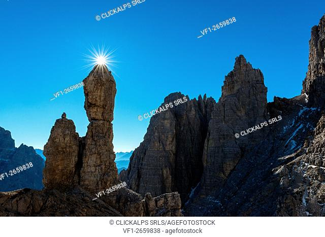 Auronzo, Dolomites, Veneto, Italy. Star sun exactly on the summit of Salsiccia near Refuge Carducci