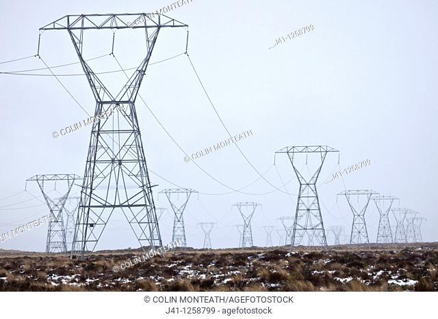 Power pylons on Rangipo desert during rain storm, Tongariro National Park