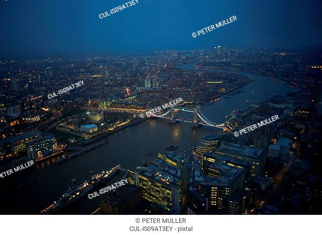 Aerial cityscape of river Thames and Tower bridge at night, London, England, UK