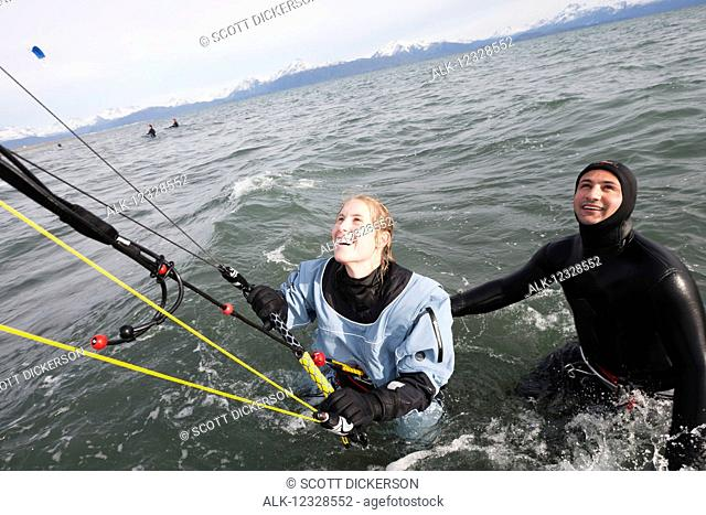 Woman taking instruction in a kitesurfing class, Kachemak Bay, South-central Alaska; Alaska, United States of America