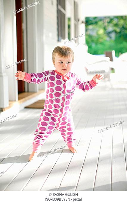 Cute female toddler on front porch