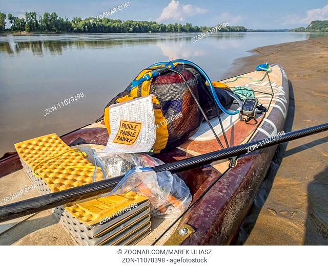 Dundee, MO, USA - August 10, 2017 - Stand up paddleboard (Starboard Expedition SUP) at rest stop during Missouri RIver 340 race