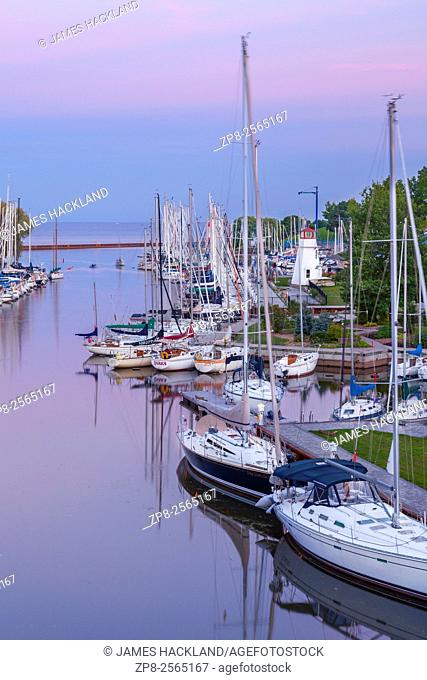 Sailboats along Sixteen Mile Creek at the Oakville Harbour at sunset. Shipyard Park, Oakville, Ontario, Canada
