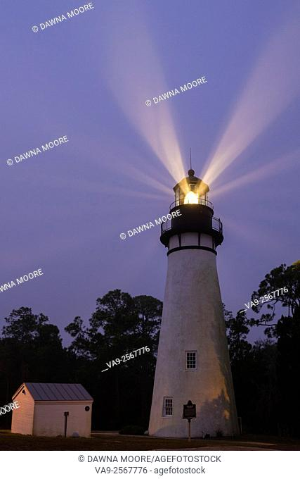Light beams shine through the fog during the early morning at Amelia Island Lighthouse in Fernandina Beach, Florida