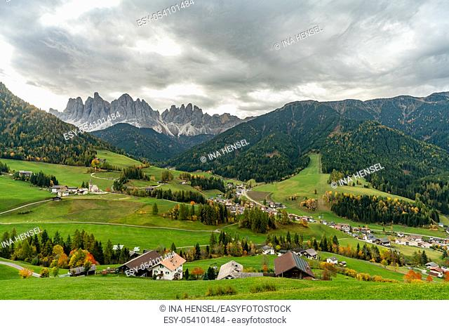 Overlooking the village of Santa Maddalena and the Villnoess valley with the Geisler massif in the background on a autumn day in october